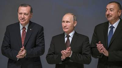 Turkey's President Recep Tayyip Erdogan, Russia's President Vladimir Putin and Azerbaijan's President Ilham Aliyev applaud during the 23rd World Energy Congress on Monday in Istanbul.